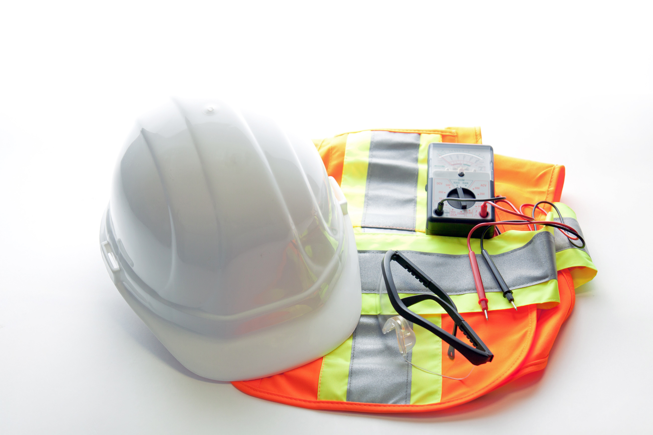 Electrical safety with meter, hard hat, vest and glasses.